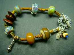 5Fish - Handmade Custom Lampwork Glass & Sterling Silver Bracelets by Krista Tseu